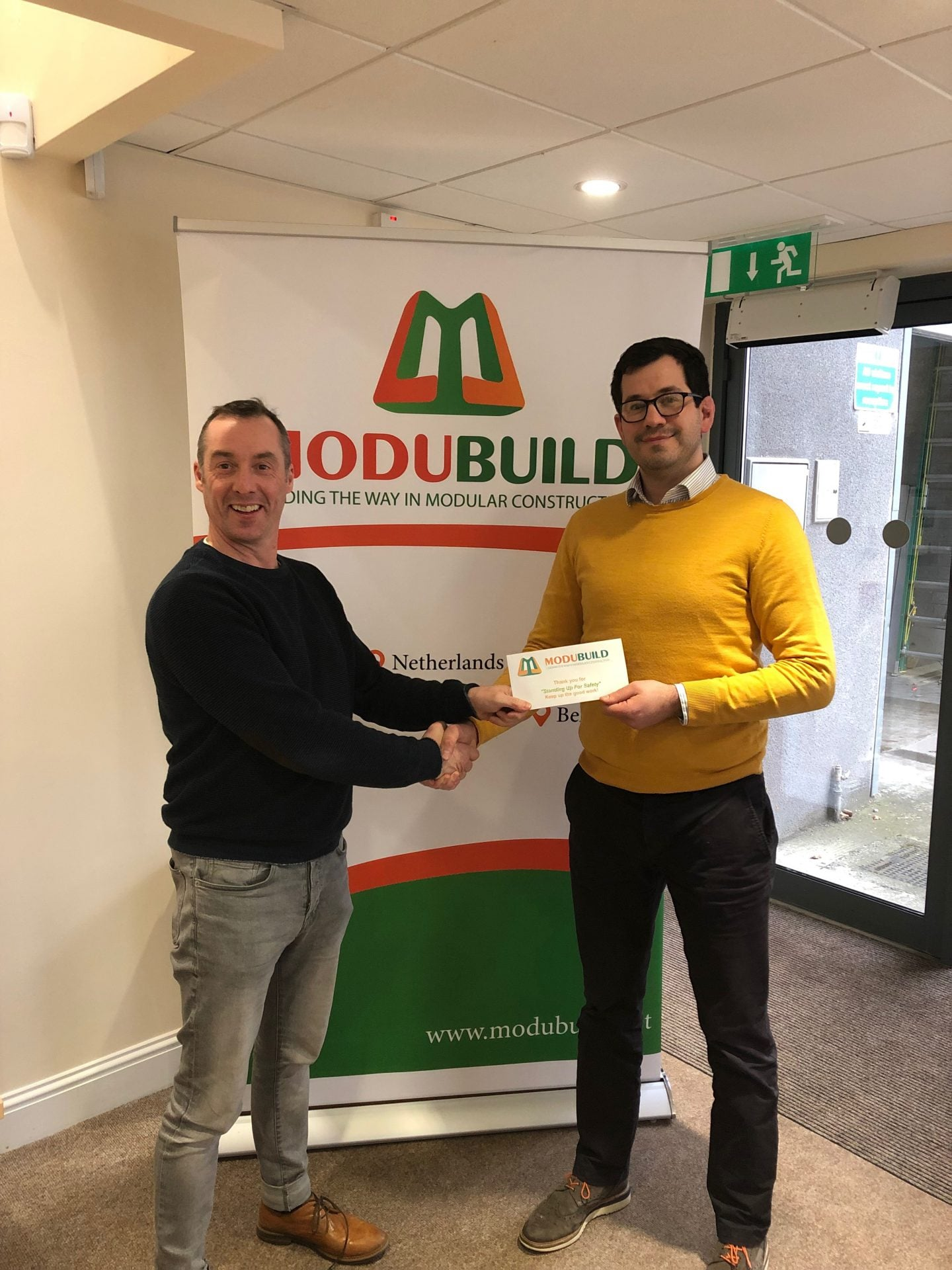 MD Kevin Brennan presents Pre-Contracts Manager James Blanchfield with safety voucher